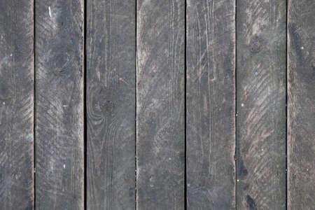 old dusty gray wooden plank wall. vertical lines. rough surface texture