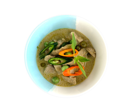 Thai green curry pork on bowl with white background photo