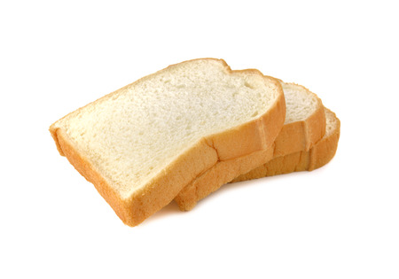 stack of sliced American white bread on white background photo