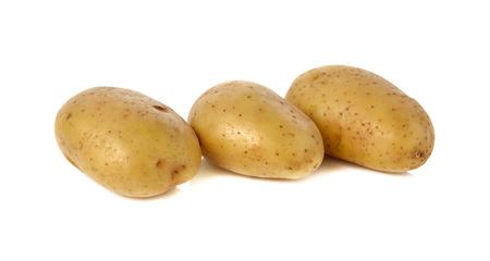 unpeeled: closeup unpeeled fresh potato on white background