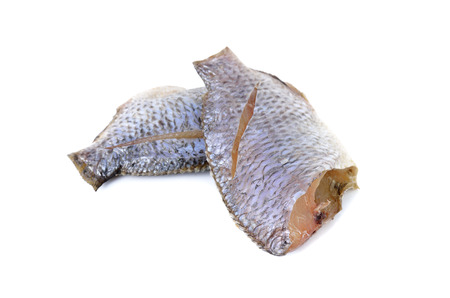 oreochromis: dried Tilapia one sun on white background