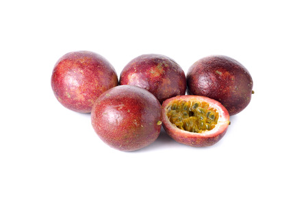 half  cut: whole and half cut passion fruits on white background