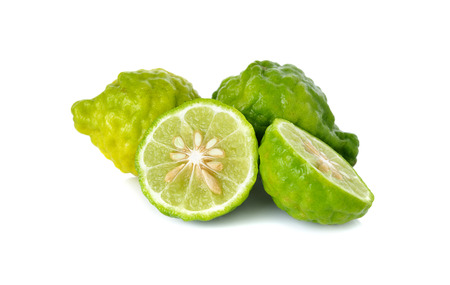 pijawka: whole and half cut fresh bergamot or Leech Lime on white background
