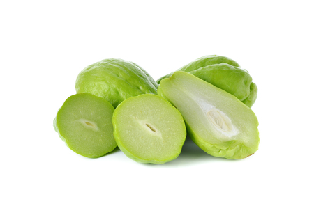 half  cut: whole and half cut fresh Chayote on white background Stock Photo
