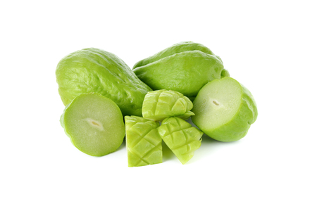 chayote: whole and half cut fresh Chayote on white background Stock Photo