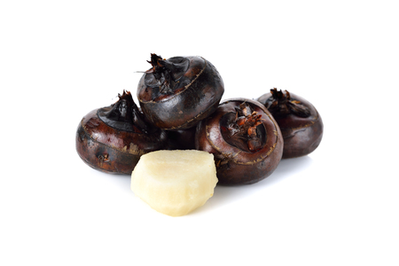 whole and peeled Chinese water-chestnut or water-nut on white background Imagens