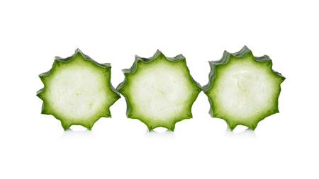 luffa: sliced Fresh Angled luffa on white background Stock Photo