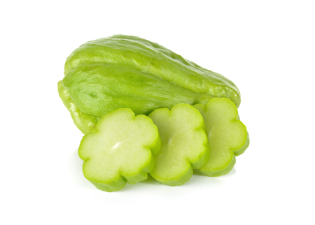 chayote: whole and sliced fresh chayote on white background