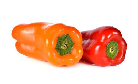 aura: fresh Aura sweet red and orange pepper on white background Stock Photo