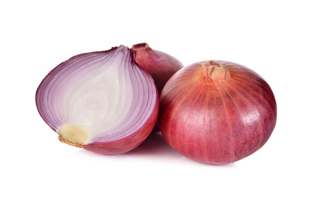 half  cut: whole and half cut red onion, shallots on white background