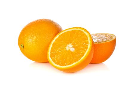 whole and cut ripe orange on white background Imagens