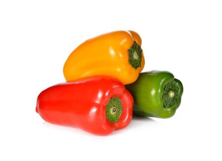 aura: fresh Aura sweet green, red, yellow pepper on white background Stock Photo