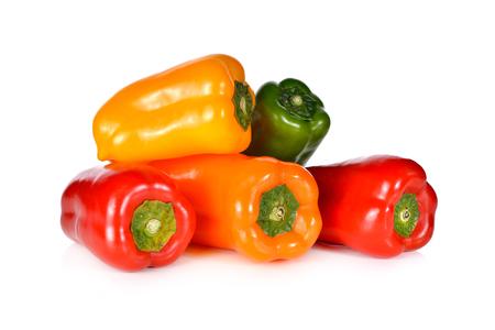 aura: stack of fresh Aura sweet red, yellow, green, orange pepper on white background