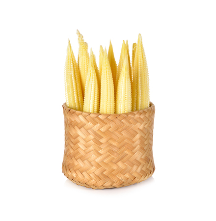baby corn: baby corn in bamboo basket on white background