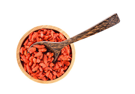 chinese wolfberry: Goji berry or Chinese wolfberry in wooden bowl on white background