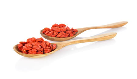 wolfberry: Goji berry or Chinese wolfberry in wooden spoon on white background Stock Photo