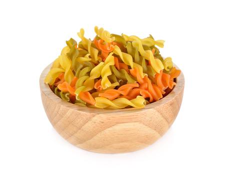 rotini: small vegeroni Rotini spirals pasta in wooden bowl on white background