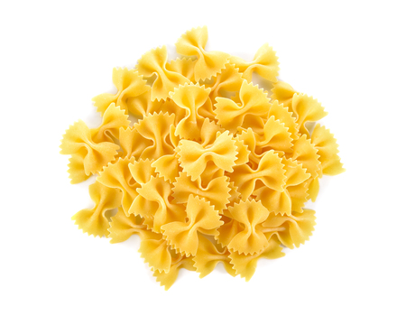 pile of Farfalle (Bow Ties) pasta on white background