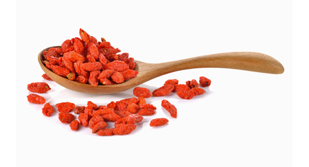 Goji berry or Chinese wolfberry in wooden spoon on white background Imagens