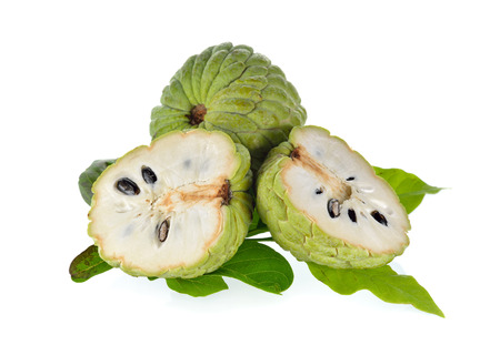 custard apple: whole and half cut custard apple with leaves on white background Stock Photo