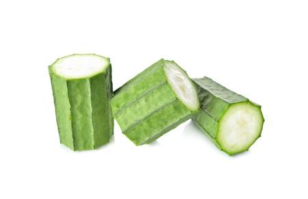 luffa: portion cut Fresh Angled luffa on white background Stock Photo