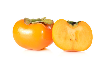 half  cut: whole and half cut ripe persimmon on white background