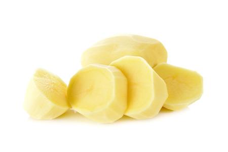 portion cut peeled potato on white background