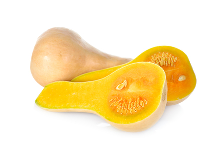 half  cut: whole and half cut fresh squash butternut on white background Stock Photo