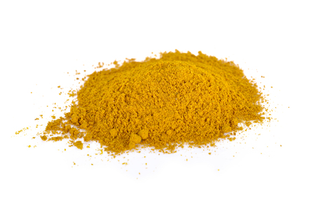 heap: pile of curry powder on white background