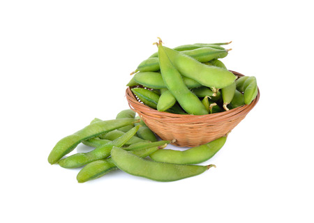 boiled Japanese green soybeans (Edamame-Japanese text) in basket and on white background Stock Photo