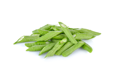 long beans: portion cut fresh yard long bean on white background