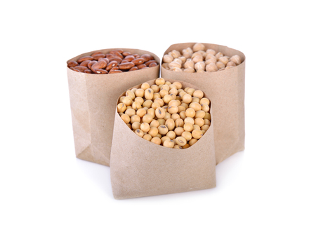haricot: dry soy bean, garbanzo and pinto bean in paper bag and on white background