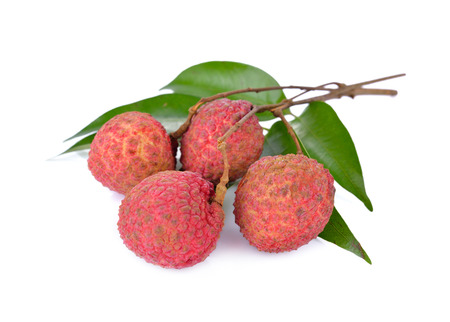 fresh Lychees with leaves and stem on white background