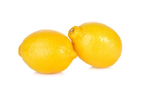 shinning: whole fresh lemon on white background