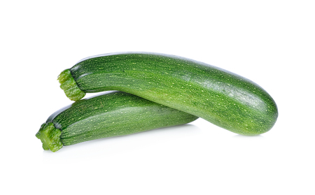 whole fresh zucchini on white background