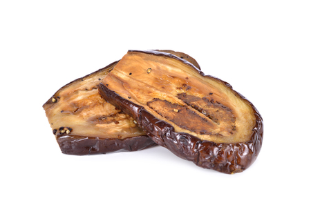 grilled purple eggplant with black pepper on white background