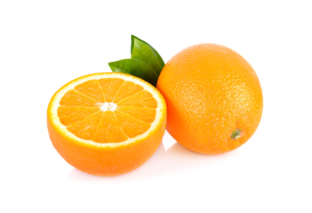 whole and half cut fresh Navel orange with leaf on white background