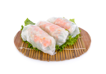 noodle roll with pork, cabbage, carrot on wooden mat and on white background Archivio Fotografico