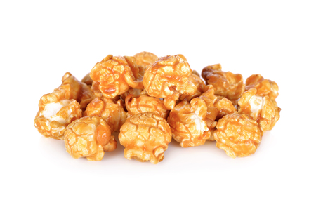 sweet butter caramel popcorn on white background Imagens