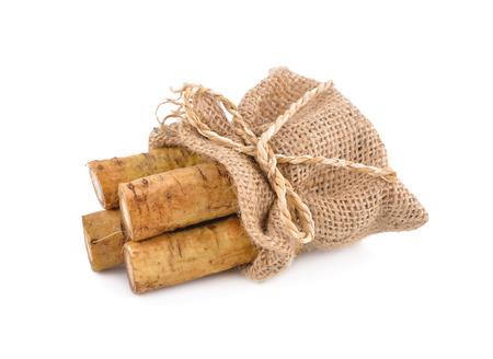 fresh burdock root or Gobo in sack on white background Stock Photo