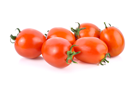 whole fresh tomato with stem on white background