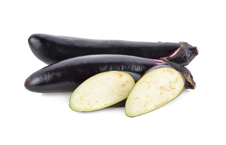 whole and sliced fresh long purple eggplant on white background Stock Photo
