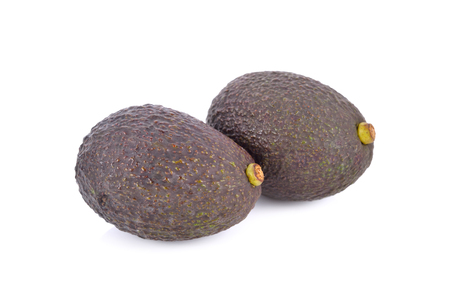 whole cut ripe avocados on white background Stock Photo