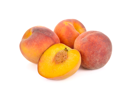 whole and half cut ripe peach on white background Stock Photo