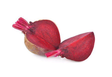 uncooked whole and cut ripe beetroot with stem on white background