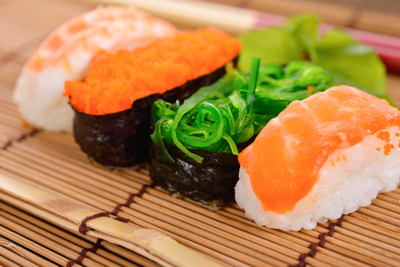 Sushi Set nigiri and sashimi served on mat chopsticks Reklamní fotografie
