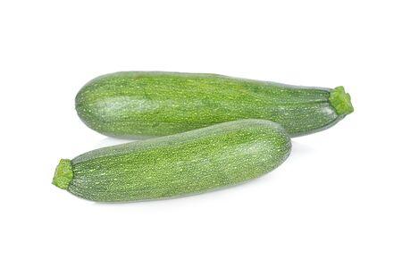 whole fresh zucchini on white background
