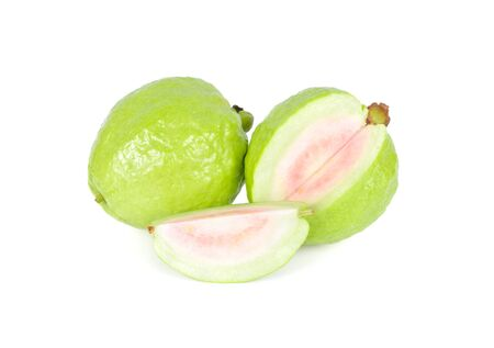 whole and cut fresh ripe pink guava on white background
