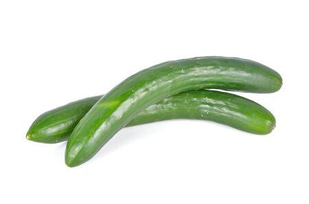 uncooked whole fresh Japanese cucumbers on white background