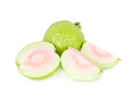 whole and half cut fresh ripe pink guava on white background